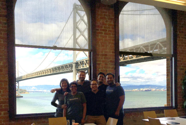Lori with her learning team in San Francisco in front of the Bay Bridge
