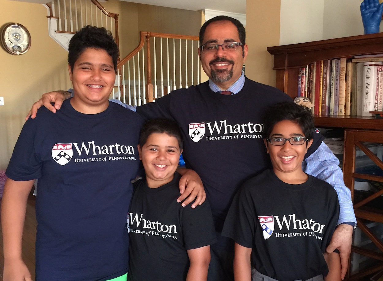 Ehab with his three sons, who inspired him as he studied for the GMATs