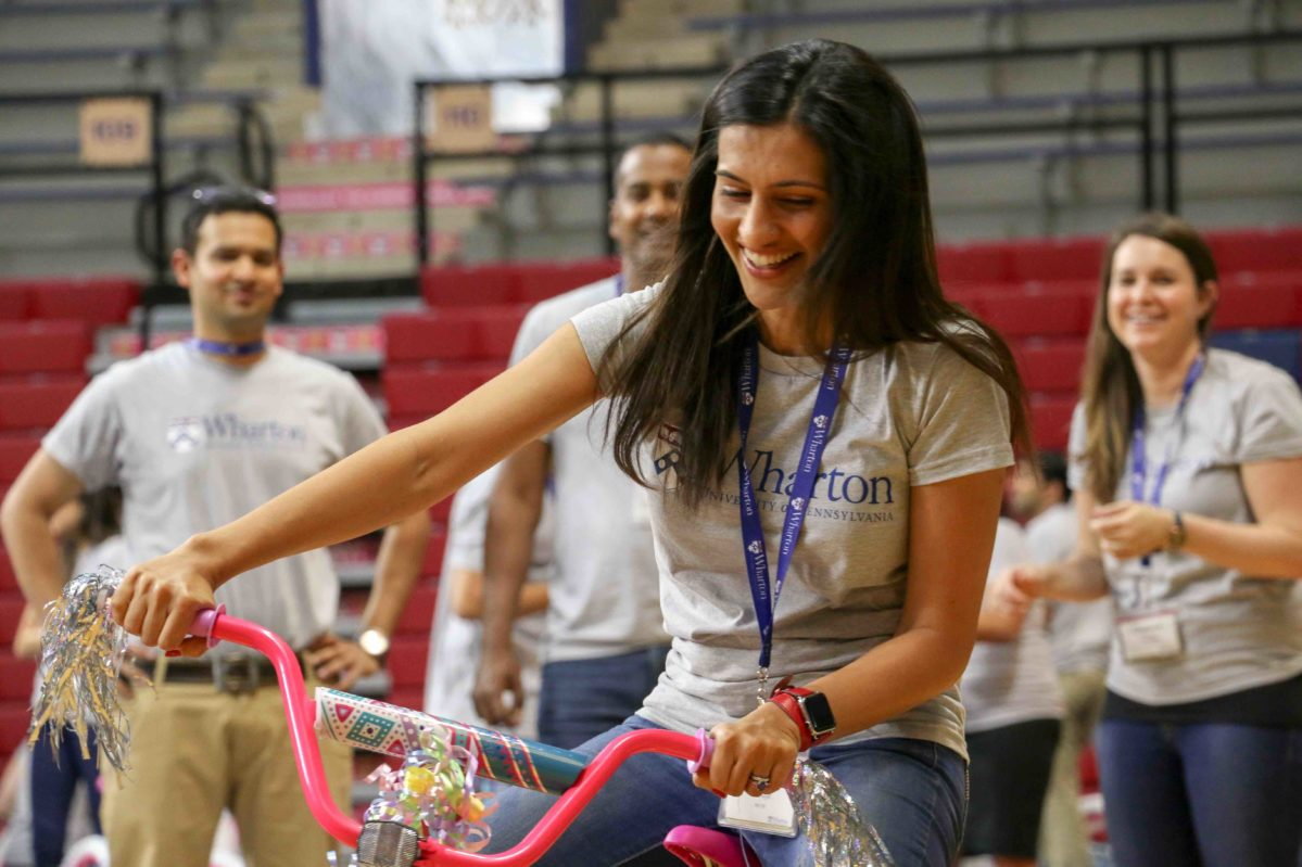 EMBA students building bikes for Orientation