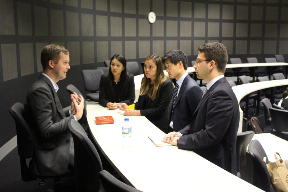 Prof. Keith Niedermeier meeting with his case team at the competition.