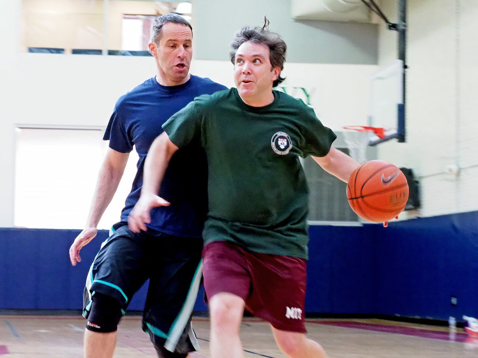 Professors Guy David and David Abrams playing basketball