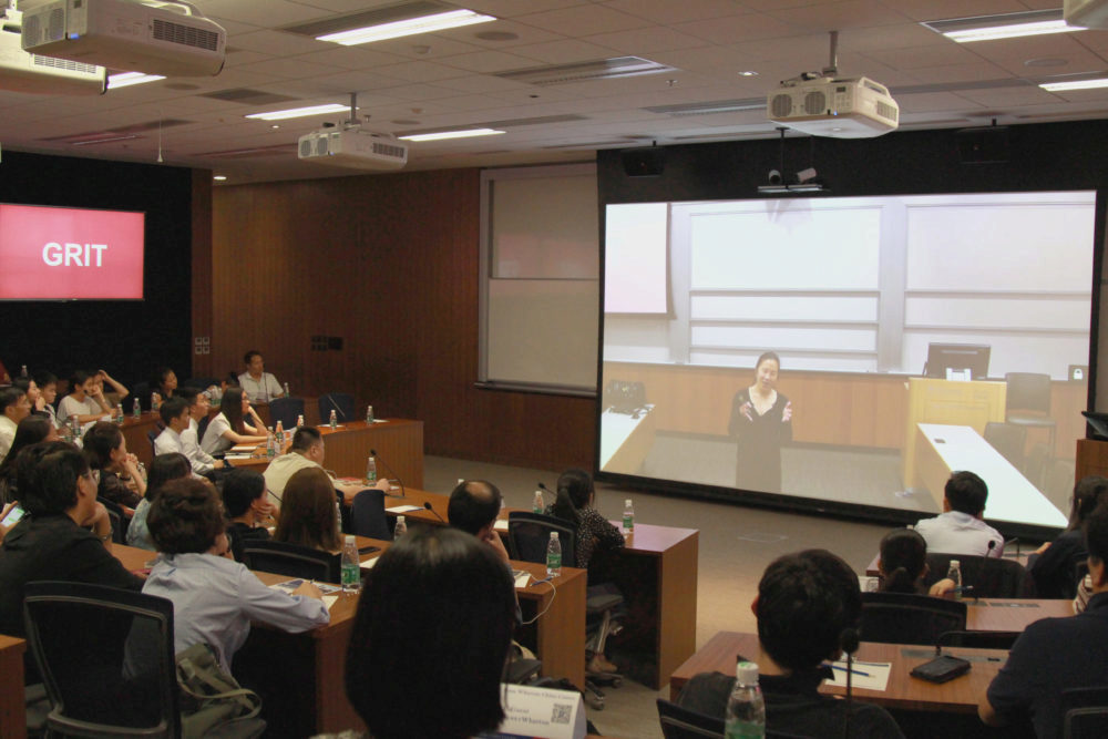 Angela Duckworth of Penn's Department of Psychology speaks to a Chinese audience via telepresence as part of the Penn Wharton Research Frontiers Speaker Series at the PWCC.