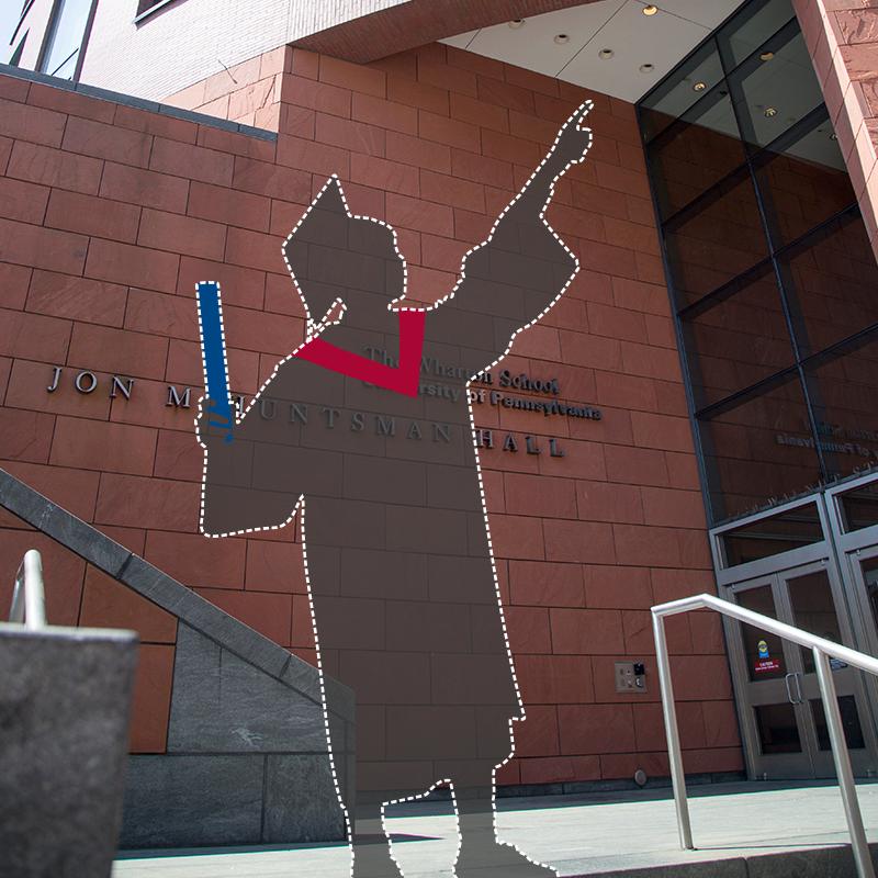 Graduate silhouette outside Huntsman Hall