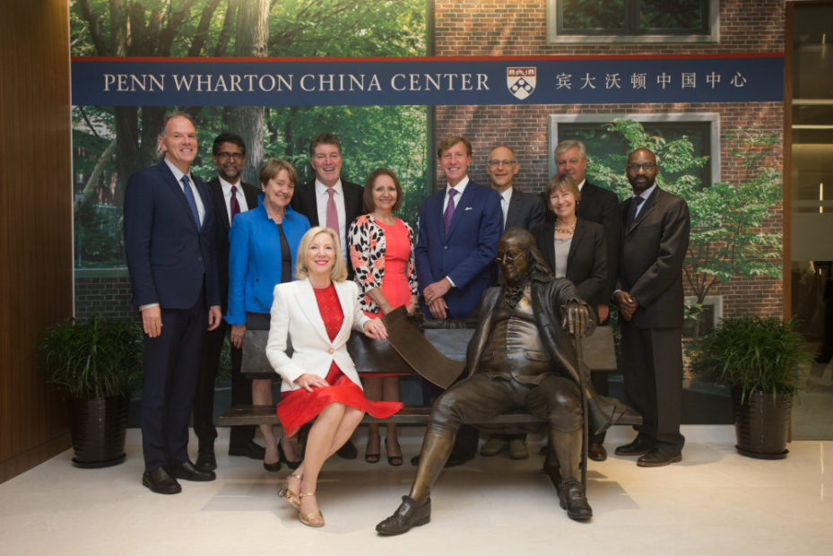 Pictured on the Ben on the Bench sculpture at the Penn Wharton China Center in Sept. 2015: Penn President Amy Gutmann (seated) with (from left to right) Wharton Dean Geoffrey Garrett; Penn Engineering Dean Vijay Kumar; former PennDesign Dean Marilyn Jordan Taylor; former Penn Dental Dean Denis F. Kinane; Penn Nursing Dean Antonia Villarruel; Perelman School of Medicine Dean J. Larry Jameson; Vice Provost for Global Initiatives Ezekiel Emanuel; Graduate School of Education Dean Pam Grossman; Penn Arts and Sciences Dean Steven J. Fluharty; and School of Social Policy & Practice Dean John L. Jackson Jr.