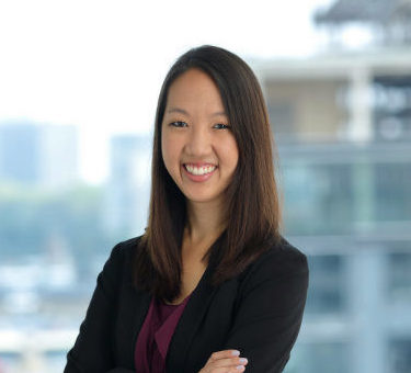 MBA student Louise Li smiling and wearing a black blazer