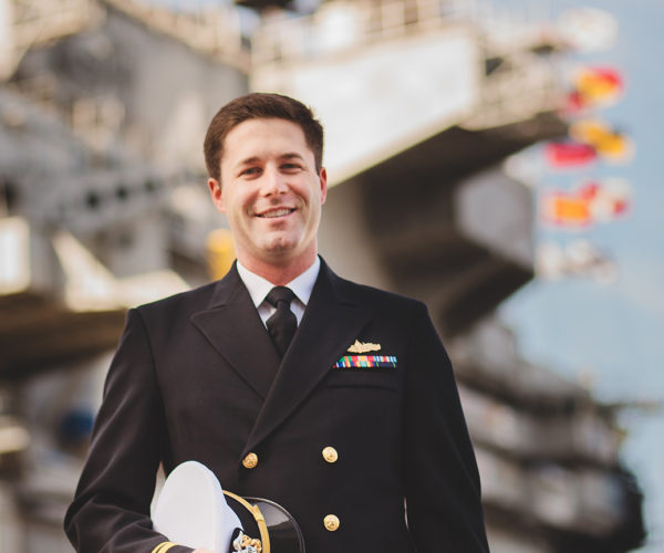 Marty Pendleton in a naval uniform in front of vessel