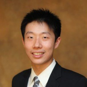 headshot of Derek Zhao in a black blazer, white shirt, and tie