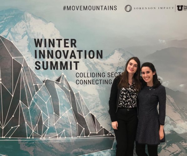 Monica Volodarsky, W'21 and Michelle Jaffee, W'19 in front of Winter Innovation Summit signage