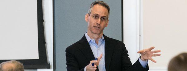 Professor Gad Allon giving lecture