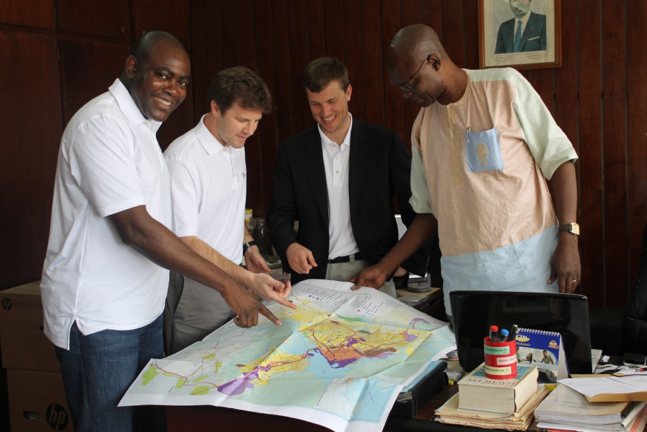 Aris, Greg, and Ben meeting with a client in Cameroon