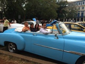 Rob with classmates in a classic car.