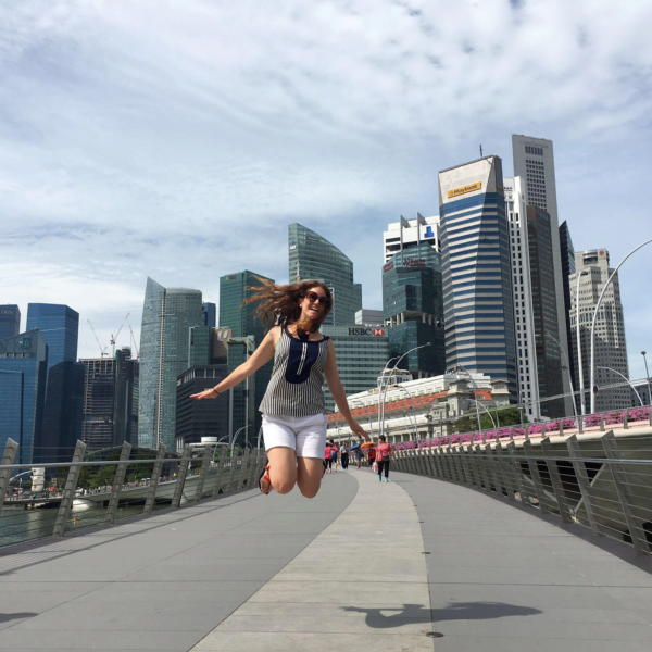 Tatiana De German jumping in the air in Singapore.
